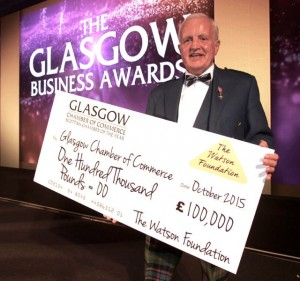 John presenting a cheque for £100,000 to be invested in helping businesses at The Glasgow Business Awards 2015 which are organised by Glasgow Chamber of Commerce Picture courtesy of Great Scot Photography.