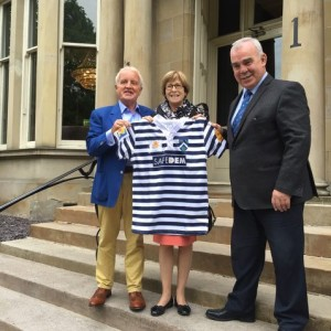 JOHN WATSON OBE (left) WITH DR JANE COLLINS OF MARIE CURIE AND GLASGOW ACCIES' DIRECTOR OF RUGBY DONALD REID